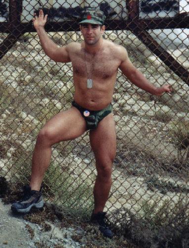 Muscular Stud John X Poses In Camo Thong Near A Marine Base!